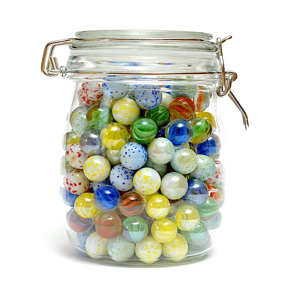 Glass jar filled with colorful marbles